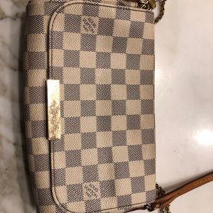 A white checkered cross body